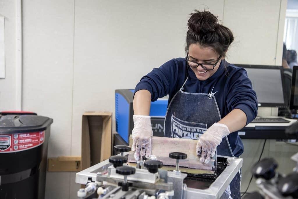 Cambridge student in screen printing class