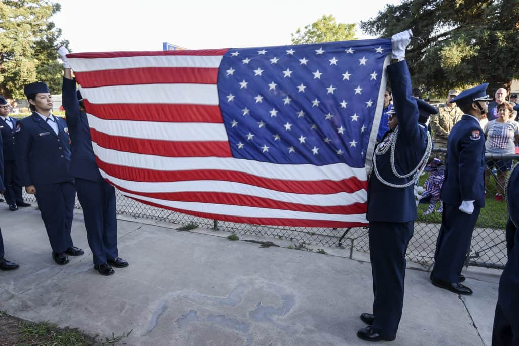 Duncan ROTC students holding American flag